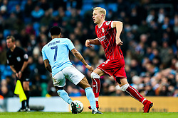 Hordur Magnusson of Bristol City is challenged by Raheem Sterling of Manchester City - Rogan/JMP - 09/01/2018 - Etihad Stadium - Manchester, England - Manchester City v Bristol City - Carabao Cup Semi Final First Leg.