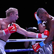 DAYTONA BEACH, FL - AUGUST 15:  Marcello Williams gets punched by Nikolay Shvab during the Alberto Ignacio Palmetta v Tre'Sean Wiggins boxing match at the Ocean Center on August 15, 2020 in Daytona Beach, Florida. (Photo by Alex Menendez/Getty Images) *** Local Caption *** Marcello Williams; Nikolay Shvab