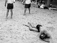 Anatoly Trofimov from Siberia colapses in the sand after completing the swim portion of the Ocean City Beach Patrol physical test. Trofimov, a student, was hoping to make the qualifing time of ten minutes to enter the Beach Patrol Academy, but he fell short. He now has to look for another job..Photo by Peter J. Casey