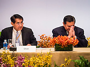 """29 MAY 2015 - BANGKOK, THAILAND:  H.E. General TANASAK PATIMAPRAGORN, (right), Deputy Prime Minister and Minister of Foreign Affairs of Thailand greets delegates during the opening of the """"Special Meeting on Irregular Migration in the Indian Ocean."""" Thailand organized and hosted the meeting at the Anantara Siam Hotel in Bangkok. The meeting brought together representatives from the 5 countries impacted by the boat people exodus: Thailand, Malaysia and Indonesia, which have all received boat people, and Myanmar (Burma) and Bangladesh, where they are coming from. Non-governmental organizations, like the International Organization for Migration (IOM) and UN High Commissioner for Refugees (UNHCR) as well as countries responding to the crisis, like the United States, also attended the meeting. A total of 22 organizations attended the one day conference.     PHOTO BY JACK KURTZ"""