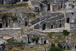 Matera, Basilicata, Italy - The Sasso Caveoso, one of two ravines honeycombed with cave dwellings that make up Matera. The town in a UNESCO World Heritage Site.