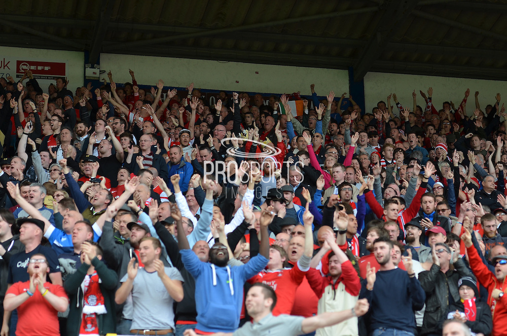 Leyton Orient fans celebrate during the Sky Bet League 1 match between Swindon Town and Leyton Orient at the County Ground, Swindon, England on 3 May 2015. Photo by Mark Davies.