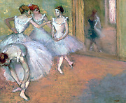 Four Dancers in the Foyer': Members of the corps de ballet in tutus chatting. Edgar Degas (1834-1917). French  Impressionist painter.