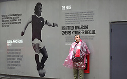 Arsenal fan outside the stadium prior to kick-off