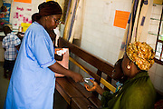 Nurse Konam Aya Marguerite hands a prescription to a patient at the NDA health center in Dimbokro, Cote d'Ivoire on Friday June 19, 2009.
