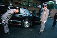 Learning to Bow: from bowing to smiling, there is a course to learn how to do it the correct way. This is called its Kata, its form, and here are some of them.<br /> MK Taxi is an institution in Tokyo for its service and professionalism. Part of this is all drivers exit the taxi and open the door for the passenger, where suitable uniform (as seen) and are trained in polite speech and manners, as well as the correct operation of a taxi, which include bowing a customer out of the cab.<br />  ©2005 Tom Wagner<br /> www.tomwagnerphoto.com