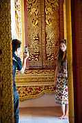 Carved gilded doors at the Wat Mai Buddhist Temple next to the National Museum  and Theater in Luang Prabang, Laos