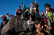 Hikers and porters hang out together on the summit of Mt. Fansipan, Lao Cai Province, Vietnam, Southeast Asia