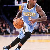 23 November 2014: Denver Nuggets guard Ty Lawson (3) dribbles during the Los Angeles Lakers season game versus the Denver Nuggets, at the Staples Center, Los Angeles, California, USA.