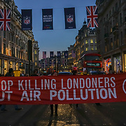 London, England, UK. 5th October 2017. Stop Killing Londoners Campaigners blockade of Oxford Street and Piccadilly Circus protest Stop Killing Londoners: Cut Air Pollution Protest No. 6 during a rush hour for 10 minutes and an extremists Black Cab driver forcefully push is away run down a protester at Piccadilly Circus. Police came to end the protest peacefully.