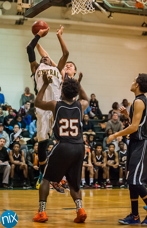 Central Cabarrus' Shalen Thomoson goes up for a shot against Northwest Cabarrus' Matthew Wheet and Anthony Caldwell Friday night at Central Cabarrus High School. Central won the game 47-46.