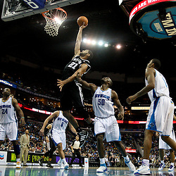 January 23, 2012; New Orleans, LA, USA; San Antonio Spurs center Tim Duncan (21) put in a rebound during the fourth quarter of a game at the New Orleans Arena. The Spurs defeated the Hornets 104-102.  Mandatory Credit: Derick E. Hingle-US PRESSWIRE