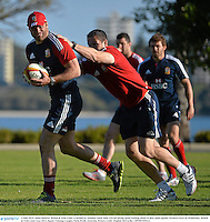 3 June 2013; Jamie Roberts, British & Irish Lions, is tackled by assistant coach Andy Farrell during squad training ahead of their game against Western Force on Wednesday. British & Irish Lions Tour 2013, Squad Training, Langley Park, Perth, Australia. Picture credit: Stephen McCarthy / SPORTSFILE