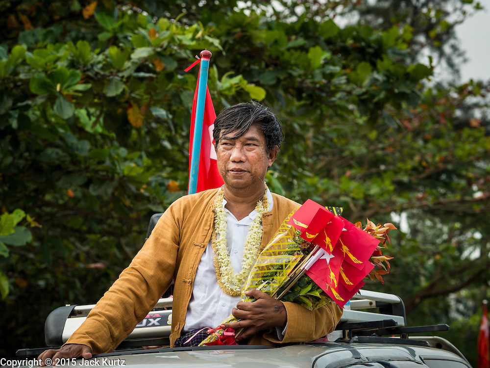 25 OCTOBER 2015 - SHWEPYITHAR, MYANMAR:  Dr. SEIN WIN, a National League for Democracy candidate for parliament, campaigns during a party motorcade in Shwepyithar, Myanmar. Political parties are in fill campaign mode in Myanmar (Burma). National elections are scheduled for Sunday Nov. 8. The two principal parties are the National League for Democracy (NLD), the party of democracy icon and Nobel Peace Prize winner Aung San Suu Kyi, and the ruling Union Solidarity and Development Party (USDP), led by incumbent President Thein Sein. There are more than 30 parties campaigning for national and local offices.    PHOTO BY JACK KURTZ