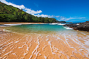 Sand and surf at Lumahai Beach, Island of Kauai, Hawaii USA
