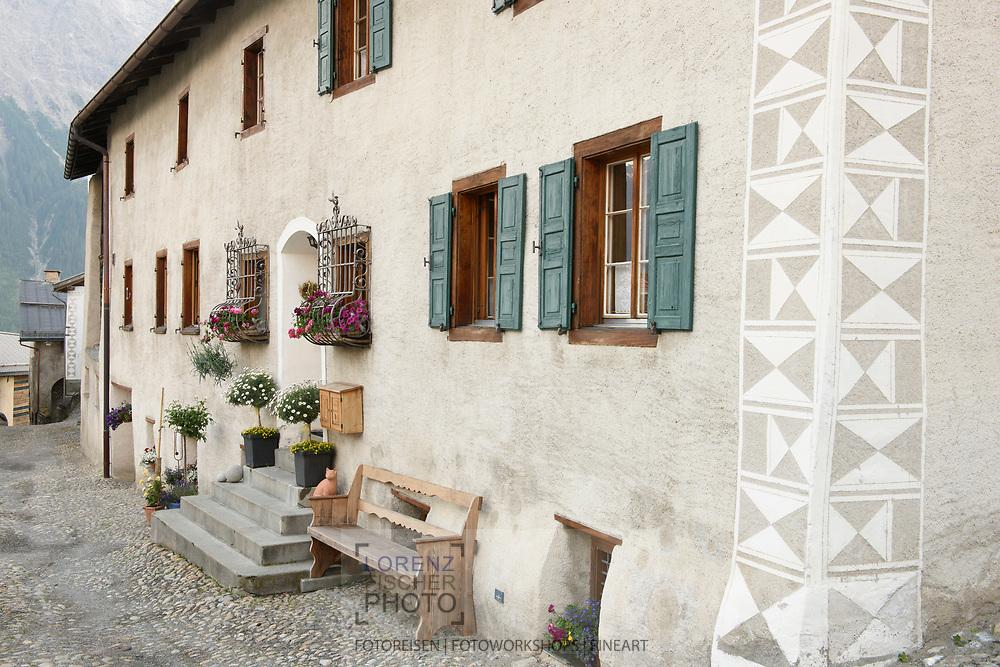 Engadinerhäuser in the small village of Latsch in the Eastern Alps of Switzerland, Naturepark Parc Ela, Grisons