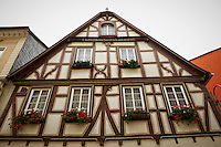 View of a German Tudor style building with windows, and flower boxes, St. Goar, Germany.