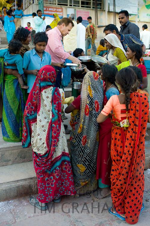 Food aid for the poor at Dashashwamedh Ghat in Holy City of Varanasi, Benares, India