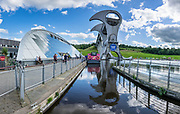 Built in 2002, the Falkirk Wheel is the world's first and only rotating boat lift. It reconnects the Forth and Clyde Canal with the Union Canal for the first time since the 1930s. The wheel raises boats by 24 metres (79 ft) in just 15 minutes, then a pair of locks raises them 11 metres (36 ft) higher to reach the Union Canal. Falkirk, central Scotland, United Kingdom, Europe. This image was stitched from several overlapping photos.