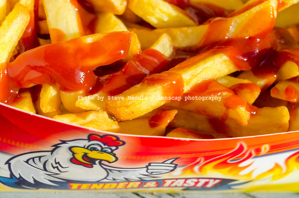 Portion of Take Away Chips with Tomato Sauce