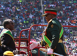 President Robert Mugabe aboard a truck as he is welcomed by Commander Of Defence Forces General Costatino Chiwenga to inspect a guard of honor during the Defence Forces commemorations at National Sports Stadium in Harare,Zimbabwe,August 15,2017.(Xinhua/Stringer) (Photo by Xinhua/Sipa USA)