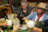 Supporters toast Jay Johnson Castro at Mi Pueblita restaurant in Matamoros after the successful completion of his 200+ mile walk to protest the proposed border fence.