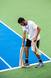 PORTOROZ, SLOVENIA - SEPTEMBER 18: Staff member drying the court during the double finals of WTA 250 Zavarovalnica Sava Portoroz at SRC Marina, on September 19, 2021 in Portoroz / Portorose, Slovenia. Photo by Nik Moder / Sportida
