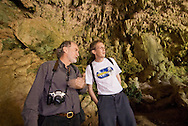 Mike Morwood, a co-discoverer of H. floresiensis, relates the geologic history of Liang Bua Cave to Christoph Zollikofer, a co-discoverer of Dmanisi Man, the oldest Hominids known outside of Africa. Oddly, the 18,000-year-old Flores fossil shares certain primitive traits with the Dmanisi-era hominids that are 1.8 million years old and thousands of miles away.