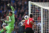 Stoke goalkeeper Asmir Begovic nervously watches a looping ball clear his goal. Barclays Premier league match, Cardiff city  v Stoke city at the Cardiff city stadium in Cardiff, South Wales on Saturday 19th April 2014. pic by Mark Hawkins, Andrew Orchard sports photography,