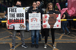 London, UK. 28th August, 2021. Animal rights activists from Camp Beagle stand with signs outside Smithfield Meat Market at the end of a National Animal Rights March. Camp Beagle is calling for the release of beagle dogs reared for animal research from MBR Acres in Huntingdon. Animal Rebellion, an offshoot of Extinction Rebellion, organised the march for the sixth day of Extinction Rebellion's Impossible Rebellion protests in London.