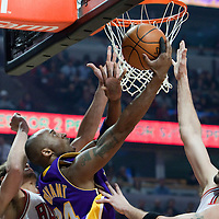 15 December 2009: Los Angeles Lakers guard Kobe Bryant goes to the basket for the reverse lay up against Chicago Bulls center Brad Miller during the Los Angeles Lakers 96-87 victory over the Chicago Bulls at the United Center, in Chicago, Illinois, USA.