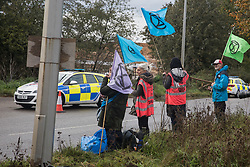 West Hyde, UK. 9th September, 2020. Anti-HS2 activists observe fellow activists blocking entrances to the Chiltern Tunnel South Portal site for the HS2 high-speed rail link. The protest action, at the site from which HS2 Ltd intends to drill a 10-mile tunnel through the Chilterns, was intended to remind Prime Minister Boris Johnson that he committed to remove deforestation from supply chains and to provide legal protection for 30% of UK land for biodiversity by 2030 at the first UN Summit on Biodiversity on 30th September.