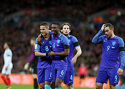 Players of the Netherlands celebrate after scoring during the International Friendly Match between England and the Netherlands at Wembley Stadium in London, Britain, on March 29, 2016. England lost 1-2. EXPA Pictures © 2016, PhotoCredit: EXPA/ Photoshot/ Han Yan<br /> <br /> *****ATTENTION - for AUT, SLO, CRO, SRB, BIH, MAZ, SUI only*****