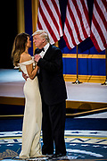 U.S. President Donald Trump and First Lady Melania Trump dance during the Armed Services Inaugural Ball in Washington, D.C., on Friday, Jan. 20, 2017. Senate Democrats and Republicans are tussling over how many of Trump's nominees can be confirmed on his first day in office, with Republicans threatening to work through the weekend to break the logjam.