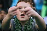 A young fan shows his disapproval of the referees during the second half of the Sounders season opener against New York, Sunday, March 19, 2017 at CenturyLink Field. The Sounders won 3-1.