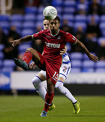 Swansea's Wayne Routledge holds off Reading's Chris Gunter during the Carabao Cup, third round match at the Madejski Stadium, Reading.