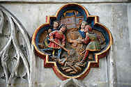 Gothic medieval sculpture from the Cathedral of Notre-Dame, Amiens, France . The Cathedral Basilica of Our Lady of Amiens or simply Amiens Cathedral, is a Roman Catholic  cathedral the seat of the Bishop of Amiens. It is situated on a slight ridge overlooking the River Somme in Amiens. Amiens Cathedral, was built almost entirely between 1220 and c.1270, a remarkably short period of time for a Gothic cathedral, giving it an unusual unity of style. Amiens is a classic example of the High Gothic style of Gothic architecture. It also has some features of the later Rayonnant style in the enlarged high windows of the choir, added in the mid-1250s. Amiens Cathedra has been listed as a UNESCO World Heritage Site since 1981. Photos can be downloaded as Royalty Free photos or bought as photo art prints. <br /> <br /> Visit our MEDIEVAL PHOTO COLLECTIONS for more   photos  to download or buy as prints https://funkystock.photoshelter.com/gallery-collection/Medieval-Middle-Ages-Historic-Places-Arcaeological-Sites-Pictures-Images-of/C0000B5ZA54_WD0s