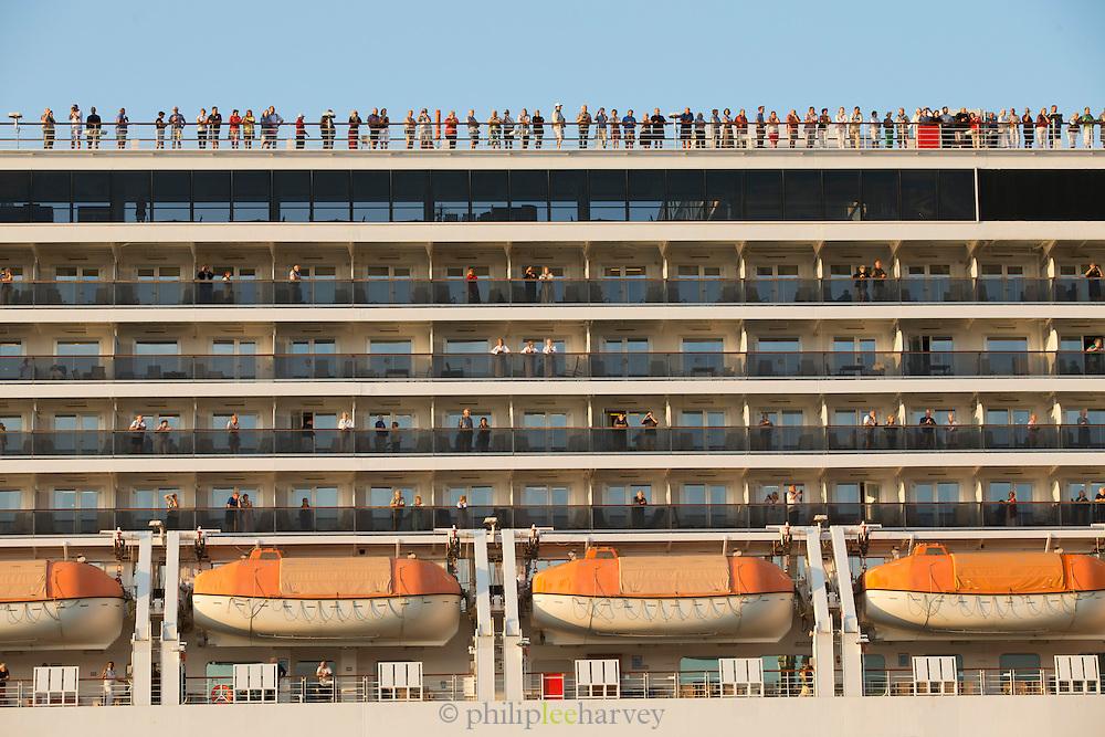 Passengers on board MV Arcadia travelling along the Canale della Giudecca, Venice, Italy, Europe