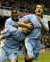 Photo. Glyn Thomas. <br /> Coventry City v Nottingham Forest. <br /> Coca Cola Championship. 06/04/2005.<br /> Coventry's Michael Doyle (R) and Shaun Goater (L) congratulate Gary McSheffrey (C) on giving them a 1-0 lead