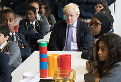 Michaela Community School, Wembley, London, June 23rd 2015. Mayor of London Boris Johnson visits the Michaela Community School, a Free School in Wembley that started taking students in September2014 after battling a certain amount of resistance from locals and unions. During the visit Head Teacher Katharine Birbalsingh took the Mayor on a tour of the school before he participated in a history lesson, prior to sitting down with pupils for brunch. PICTURED: The Mayor sits down with pupils for brunch. Each table has an adult who encourages conversation and participation by all students.