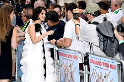 Charlotte Riley signs autographs for fans whilst attending the Swimming with Men premiere held at Curzon Mayfair, London. Photo credit should read: Doug Peters/EMPICS
