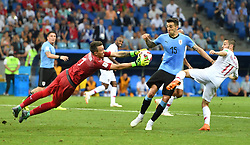 SOCHI, June 30, 2018  Goalkeeper Fernando Muslera (L front) of Uruguay saves the ball during the 2018 FIFA World Cup round of 16 match between Uruguay and Portugal in Sochi, Russia, on June 30, 2018. Uruguay won 2-1 and advanced to the quarter-final. (Credit Image: © Liu Dawei/Xinhua via ZUMA Wire)