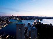 Sydney harbour  with Sydney Harbour Bridge and the Sydney Opera House at dusk. Sydney, New South Wales, Australia