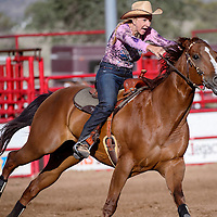 070214       Cable Hoover<br /> <br /> Lynn Beshears pushes her horse to go faster between barrels during the Senior Pro Rodeo at the Grants Rodeo Grounds Wednesday.