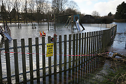 © Licensed to London News Pictures. 22/02/2014. Basingstoke, Hampshire. A children's play area in West Ham Park, Basingstoke closed due to groundwater flooding. Groundwater levels are continuing to rise in the area, forcing 69 homes to be evacuated in the Buckskin Area of the commuter town. Photo credit : Rob Arnold/LNP
