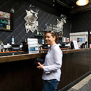 Proud Camden is located in the 200-year-old Grad II Listed Horse Hospital in the Stables Market, Camden. Adorned by images of rock throughout, it retains many of the beautiful and genuine features, including the original stables that once housed the horses. The bar has developed a cult following and become a celebrity hang-out, with regulars Amy Winehouse and many others. The original horse stables have been converted into seven quirky, individually designed booths which can be used as private backstage areas or public showrooms. From Proud's glass-walled space you catch some epic views of the notorious Camden streets. The main Bar of Proud Camden pub
