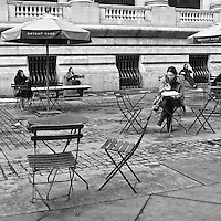 Connected and yet disconnected from each other in front of the New York Public Library.