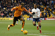 Preston North End midfielder Daniel Johnson and Wolverhampton Wanderers defender Dominic Iorfa tussle during the Sky Bet Championship match between Wolverhampton Wanderers and Preston North End at Molineux, Wolverhampton, England on 13 February 2016. Photo by Alan Franklin.
