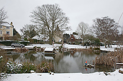 © Licensed to London News Pictures 08/02/2021.        Otford, UK. A picturesque view of Otford's duck pond roundabout in Kent. The Met Office has warned of more freezing cold snowy weather to come with yellow and amber alerts in place for London, Kent and the South East. Photo credit:Grant Falvey/LNP