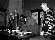 23/11/1964<br /> 11/12/1964<br /> 23 November 1964<br /> <br /> Dr. Kenneth Kuanda, President of Zambia receiving an Honorary Degree <br /> <br /> Dr. Kuanda President of Zambia signing the Register after receiving the degree from President Éamon de Valera. Chancellor of the National University of Ireland Also in the Picture Dr. Seamus Wilnot Register N.U.I. and Dr. John J. McHenry Vice Chancellor N.U.I. President University College Cork